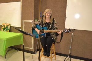 Sharon Schulz PBE Speech Pathologist provides background music