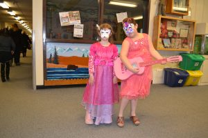 First Friday had a Masquerade Theme...two students show off their masks they made,